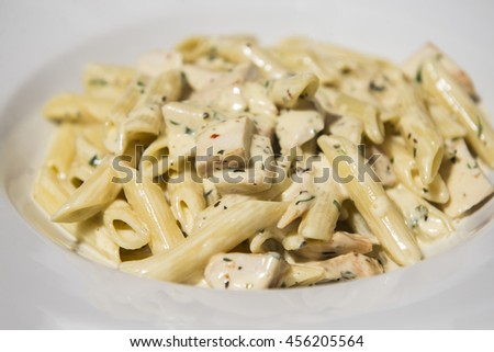 Penne with salmon creamy sauce - stock photo
