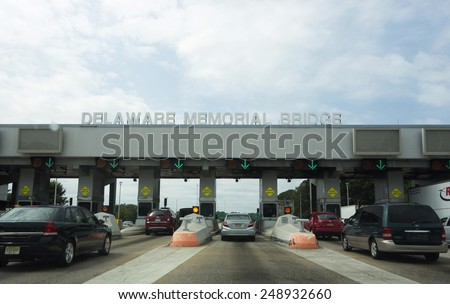 Pennsville, New Jersey, August 31;  The tollbooths in Pennsville, New Jersey before entering on to the Delaware Memorial Bridge.  This span connects New Jersey to Delaware on August 31, 2014. - stock photo