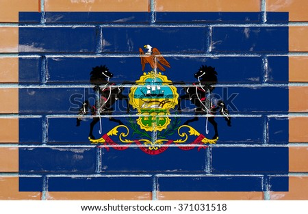 Pennsylvania state flag of America on brick wall - stock photo