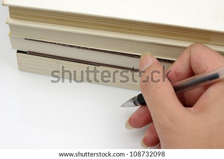 Pens and books (to express the concept of reading) - stock photo