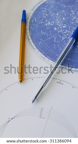 Pens and galatic map in the school or college for students  - stock photo