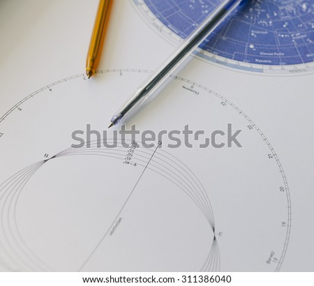 Pens and star galatic map on the school or college table for students - stock photo