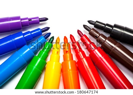 Pens in colors like a rainbow, purple to red, brown and black. Cutout, isolated on white background. - stock photo