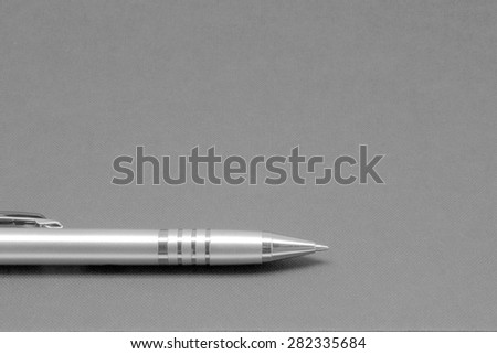 pens on a background of the book cover - stock photo