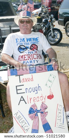 PENSACOLA - APRIL 15:  An estimated 1000 tax day Tea Party protesters peacefully assembled to voice their concern over government spending on April 15, 2010 in Pensacola, Florida. - stock photo