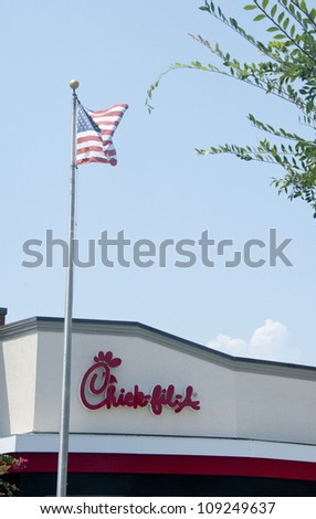 PENSACOLA, FL - AUGUST 1: American flag flies over Chick-Fil-A  in Pensacola, FL, on August 1, 2012 on national Day of Support following backlash from the owner supporting traditional marriage.