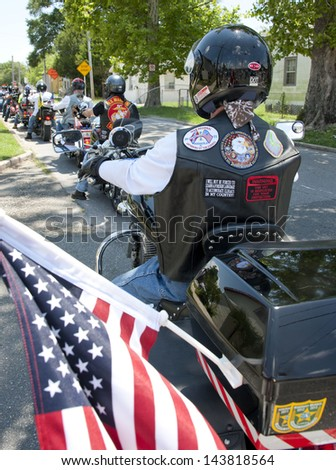 PENSACOLA, FL - JUNE 22: Patriot Riders and more gather at church of fallen Army SSGT Jesse Thomas in Pensacola, FL on June 22, 2013 to counter possible demonstration by Westboro Baptist Church. - stock photo