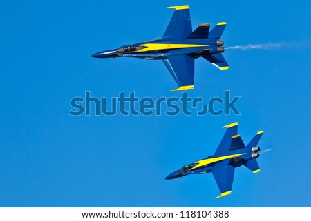 PENSACOLA, FL - NOVEMBER 2:US Navy Blue Angels in F-18 Hornet planes perform in air show routine in Pensacola, FL on November 2, 2012. Blue Angels are the oldest active aerobatic team in the world - stock photo