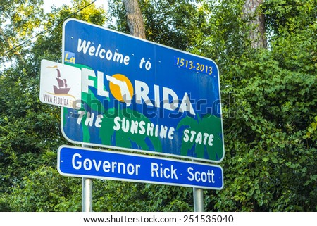 PENSACOLA, FLORIDA - JULY 18, 2013: Welcome sign to the state of Florida in Pensicola, USA. The area is ruled by Governor Rick Scott. - stock photo