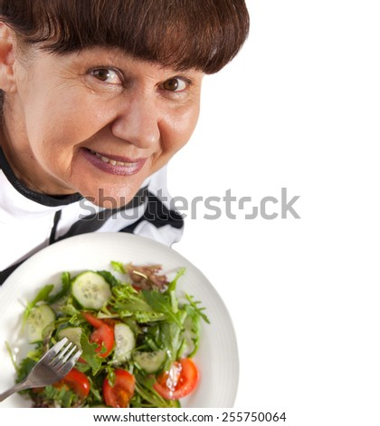 Pension age woman in sport costume with salad. Healthy life style concept - stock photo