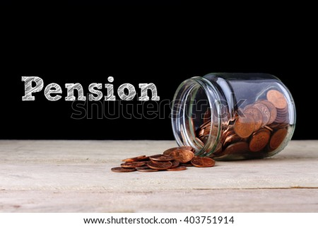 pension concept - coin out of jar.. - stock photo