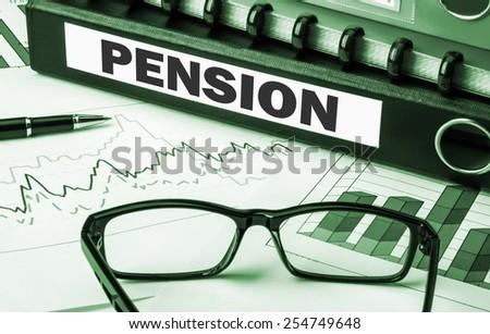 pension on business document folder - stock photo