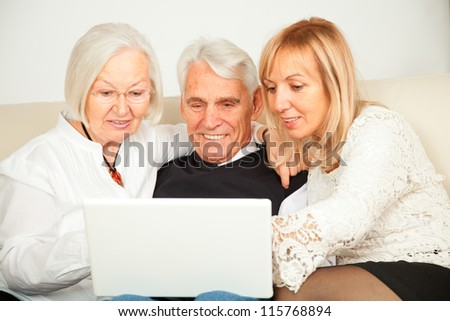pensioner couple and daughter - stock photo