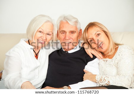 pensioner couple with daughter - stock photo