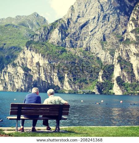 Pensioner enjoying their time at a lake. - stock photo