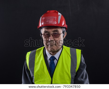pensioner in a construction helmet