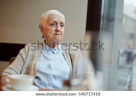 Pensioner in cafe