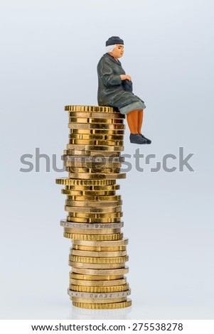 pensioner sitting on money stack, symbol photo for retirement, pension, old-age insurance - stock photo