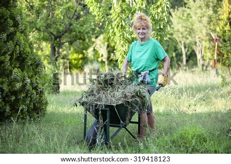 Pensioner with red hair at garden works