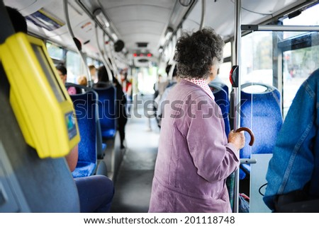 Pensioner woman inside the bus - stock photo