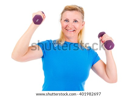 Pensioner woman sport. Old senior woman is engaged in inside sports. Woman looking at camera, holding violet dumbbells and cheerfully smiling while doing sport exercises. isolated on white background