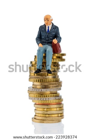 pensioners sitting on a pile of money, symbolic photo for pension, retirement, pension - stock photo