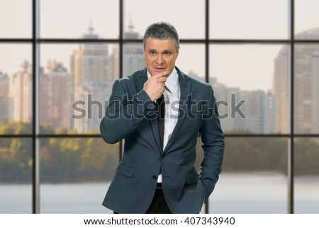 Pensive adult businessman in suit. Thoughtful businessman on daytime background. Man's decision and responsibility. Politician must win the elections. - stock photo