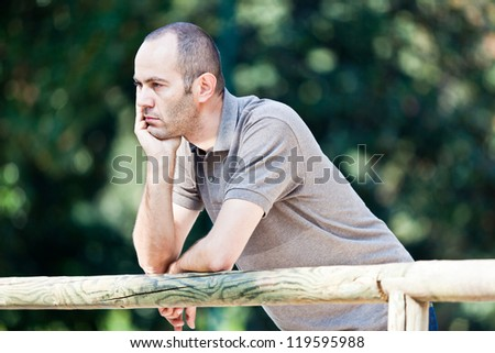 Pensive Adult Man at Park - stock photo