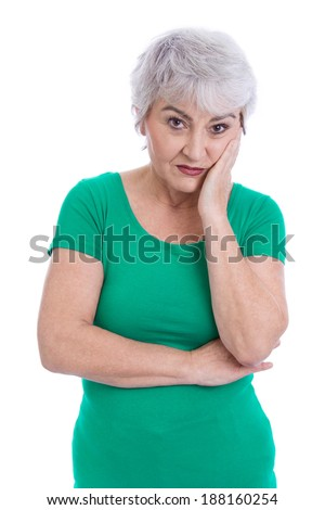 Pensive and sad older woman isolated on white. - stock photo