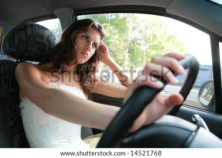 pensive beautiful girl driver controls car