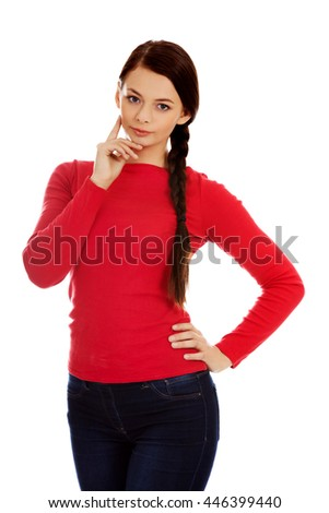 Pensive beautiful young student woman - stock photo