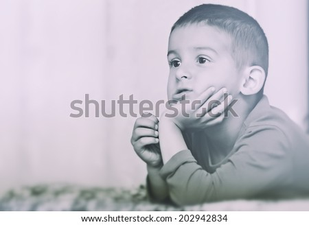 Pensive boy - stock photo