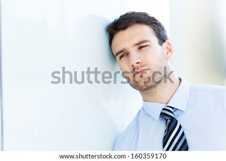 Pensive business man - stock photo