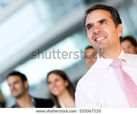 Pensive business man at the office looking up - stock photo