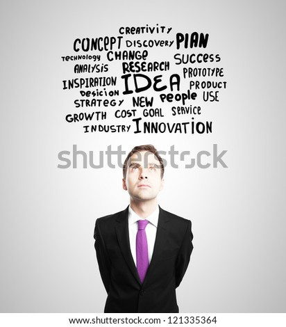 Pensive businessman and business tags - stock photo