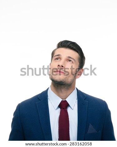 Pensive businessman looking up at copyspace isolated on a white background - stock photo
