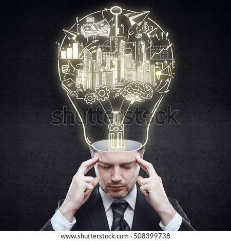 Pensive businessman with abstract business sketch inside light bulb head on dark background. Idea concept