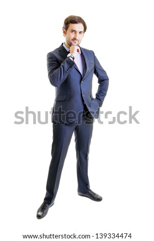 Pensive businessman with hand on hip, white background - stock photo