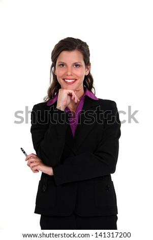 Pensive businesswoman holding pen - stock photo