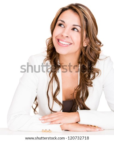 Pensive businesswoman looking very happy - isolated over a white background - stock photo