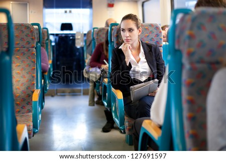 Pensive businesswoman on the train
