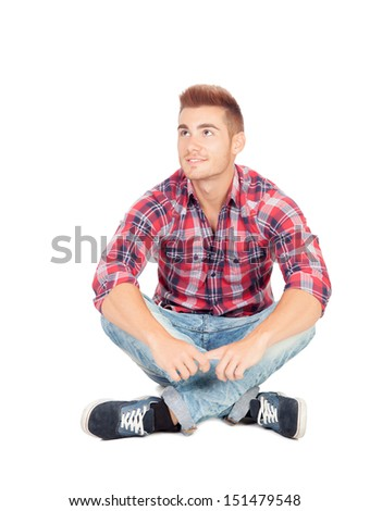 Pensive casual boy sitting on the floor isolated on white background