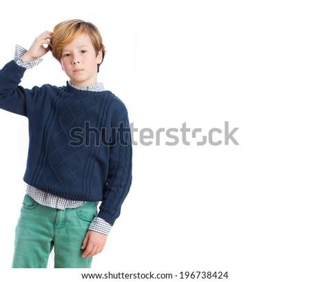 Pensive child posing - stock photo