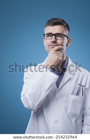 Pensive doctor with lab coat thinking with hand on chin - stock photo