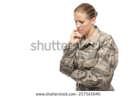 Pensive female airman with hand on chin - stock photo