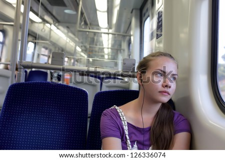 Pensive girl in subway train, Athens, Greece - stock photo