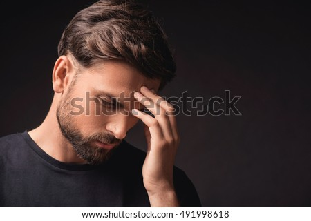 Pensive guy trying to solve a problem