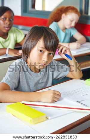 Pensive Japanese child in class in elementary school