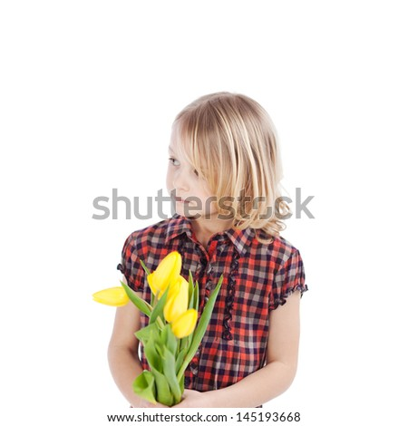 Pensive little girl with a bunch of fresh yellow spring tulips in her hands staring thoughtfully off to the left of the frame isolated on white - stock photo