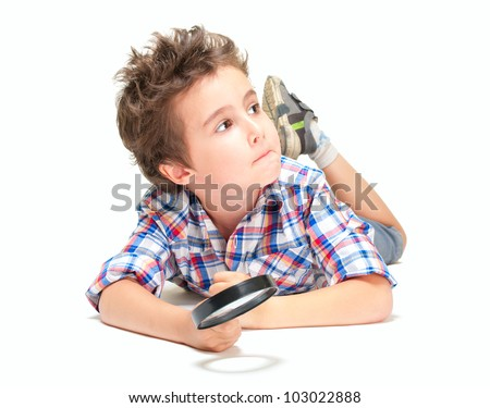 Pensive little researcher boy with weird hair and magnifier isolated on white - stock photo